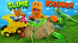 GREEN SLIME Volcano filled with cars & dinosaurs! t-rex in metallic slime! Family Friendly dinosaurs