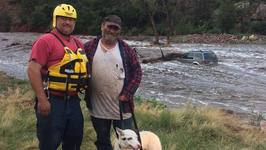 Man and Dog Rescued From Submerged Vehicle During Flash Flooding