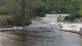 Severe Flooding In Canyon Submerges Bridge