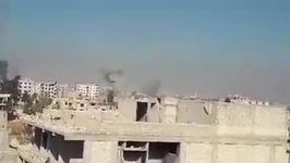 Smoke Rises From Buildings Amid Strikes on Douma