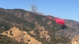 Plane Drops Fire Retardant on Canyon Fire Near Corona