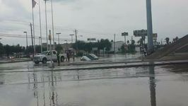 Cars Swamped by Floodwaters as Super Cell Sweeps Through Laredo