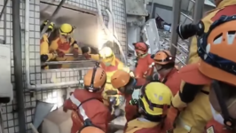 Search and Rescue Team Evacuates Leaning Building as Earthquake Aftershocks Felt