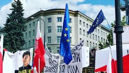 Warsaw Protesters Wave Flags, Chant Outside Parliament Building