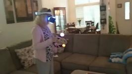 Enthusiastic Grandparents Play Virtual Reality Video Game