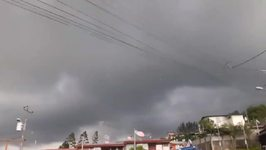 Possible Tornado Lifts Debris in Cartago, Costa Rica