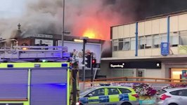Firefighters Battle Blaze at Poundland in Chingford