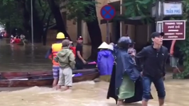 Civilians Wade Through Waterlogged Streets of Hoi An's Ancient Town