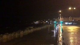 High Tides in Galway Spill Onto Road as Storm Brian Arrives
