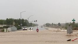 Monsoon Flash Floods Sweep Away Road Signs In Las Vegas