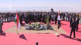 Former President's Grave Flanked by Iraqi and Kurdish Flags After Controversial Funeral