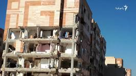 People Look Through Remains of Apartment Blocks to Salvage Items After Earthquake