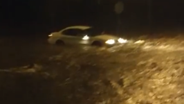 Driver Gets Stuck in Kansas City Floodwater