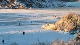 Ice Skaters Take to Alaska Glacier's Lake