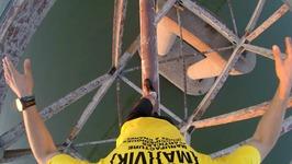 Unicycle on giant bridge over Danube