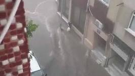 Stream of Water Flows Down Istanbul Street Amid Thunderstorm