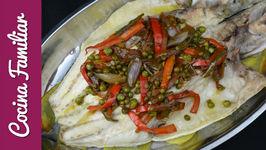 Lubina al horno con patatas y wok de verduras