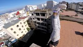 Fearless Thrill Seeker Balances On Roof Top