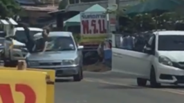 Driver Hits Thai Man With Car, Gets Punched in Front of Police