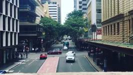 Person Appears to be Skateboard Skitching in Brisbane