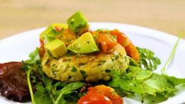 Fish Cakes With Avocado And Roasted Tomato Relish On Arugula Salad
