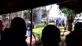 Waiting Kenyan Voters Cheer Elderly Lady Arriving to Cast Her Ballot
