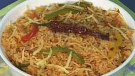Cheesy Pepper Rice by Tarla Dalal
