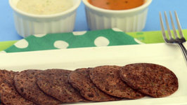 Ragi and Coriander Uttapa (Calcium and Iron Rich Snack) by Tarla Dalal