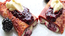 Red Velvet Crepes with Cheesecake Filling and Blackberry Coulis