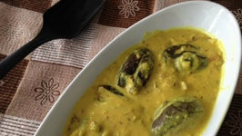 Stuffed Eggplant Curry ( Baby Eggplant in Punjabi Kadhi Sauce)