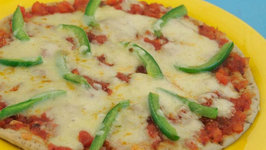 Quick Tomato Pizzas by Tarla Dalal