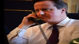 British Prime Minister Mocked on Twitter for Serious Phone Call Selfie