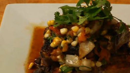 Latin Grilled Pork Chops with Fire Roasted Tomato Corn Salsa and Black Beans