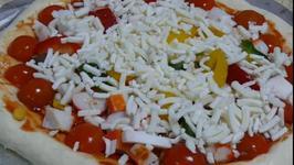 Home-made Pizza by Quatari Chef