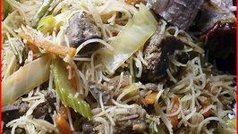Pancit Bihon - Filipino Stir Fried Chicken and Vegetables with Rice Noodles