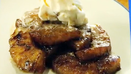 Caramelized Grilled Pineapple with ice cream and Rum Sauce