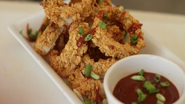 Beer-Batter Baked Onion Rings with Drunken BBQ Sauce