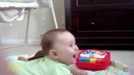 Adorable Baby Hysterically Laughs At Dog's Bark