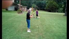 Grandma bats a ball in grandson's face