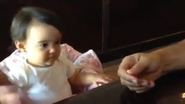 Adorable baby girl wants to hold hands with Daddy