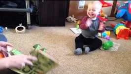 Baby boy applauds each new page of pop-up book