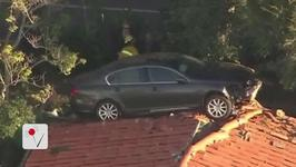 Out-of-Control Car Ends up on Roof