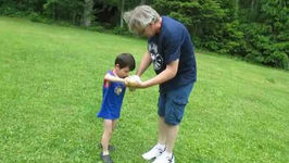 Adorable blind boy plays backyard baseball with his dad