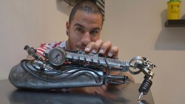 Prosthetic Arm is Tattoo Gun for Artist from France