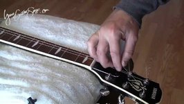 Changing Strings on an Acoustic Guitar - Part 2 - Easy Video