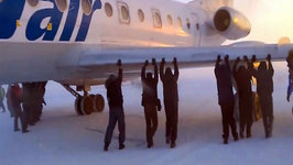 Passengers Push-start Frozen Plane in Arctic Circle