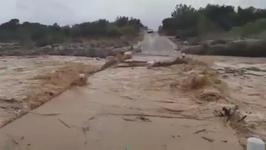 Dry River Floods Road after Torrential Rain