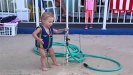Adorable Baby Girl Battles The Water Hose