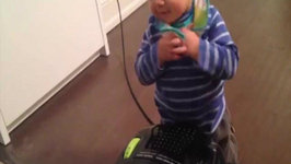 Adorable Baby Doesn't Understand The Vacuum