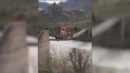 Driver Skillfully Maneuvers Tractor Over Narrow Bridge
